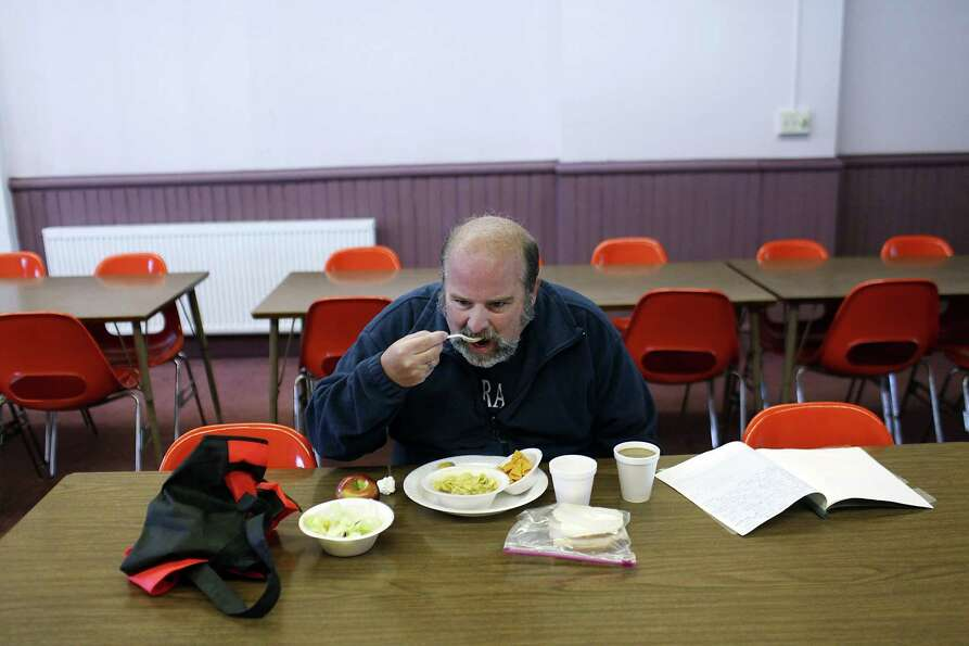 UTICA, NY - MAY 15: Mike Patterson, who is currenlty without employment, eats lunch at Mother Marian