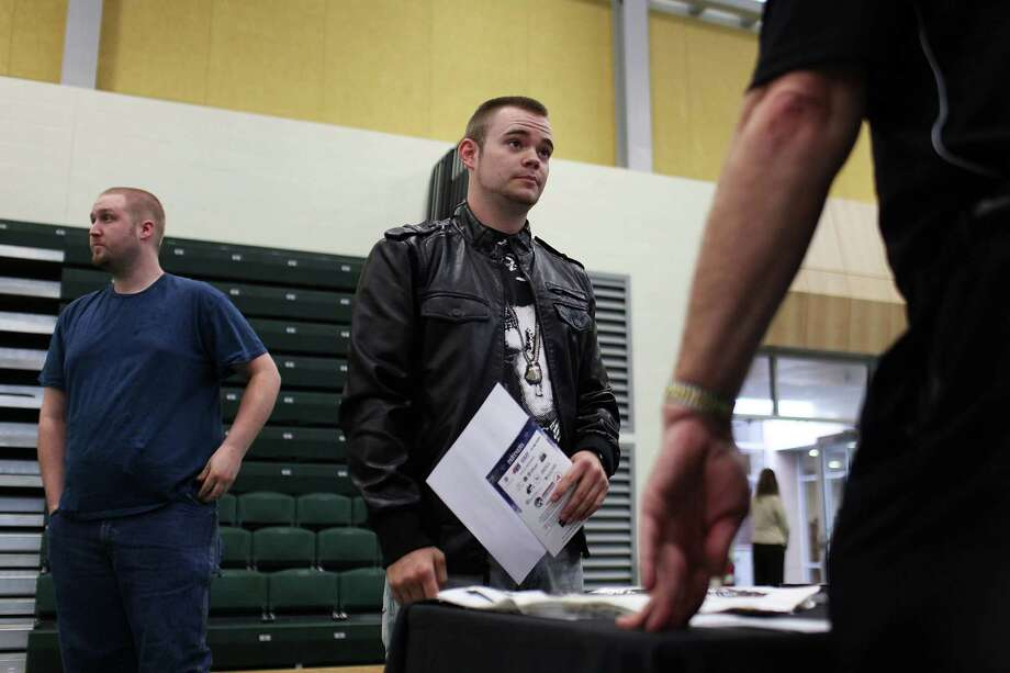 UTICA, NY - MAY 15:  Nathan Oldick, with the National Guard and who is currently unemployed, speaks with a representative from a company at the Hiring Our Heroes Veterans/Military job fair on May 15, 2012 in Utica, New York. Like many upstate New York communities, Utica is struggling to make the transition from a former manufacturing hub. The city's individual poverty rate is twice the national average with an unemployment rate of 9.8 percent as of February 2012. Citing Utica's weakening financial margins over the past two years, Fitch Ratings downgraded its credit rating on Utica by two notches to a triple-B, two rungs above junk territory. Photo: Spencer Platt, Getty Images / 2012 Getty Images
