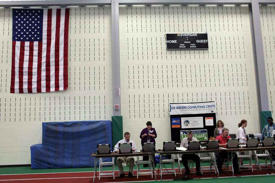 UTICA, NY - MAY 14: Veterans use computers to update their resumes and to search for work at the Hiring Our Heroes Veterans/Military job fair on May 15, 2012 in Utica, New York. Like many upstate New York communities, Utica is struggling to make the transition from a former manufacturing hub. The city's individual poverty rate is twice the national average with an unemployment rate of 9.8 percent as of February 2012. Citing Utica's weakening financial margins over the past two years, Fitch Ratings downgraded its credit rating on Utica by two notches to a triple-B, two rungs above junk territory. Photo: Spencer Platt, Getty Images / 2012 Getty Images