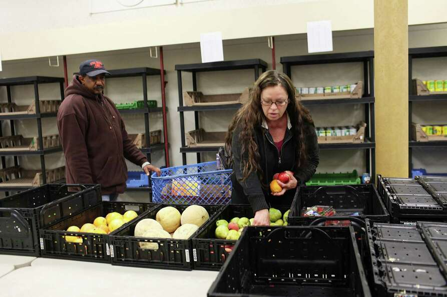 UTICA, NY - MAY 15:  Meagan Stokey picks out food at a food bank on May 15, 2012 in Utica, New York.