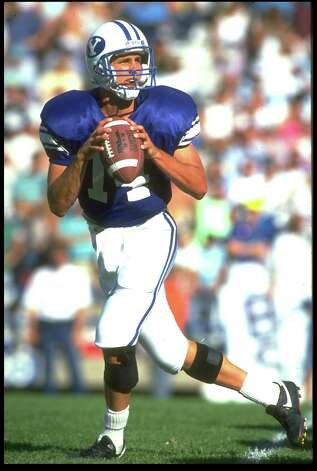 22 Sep 1990: BYU QUARTERBACK TY DETMER DROPS BACK TO PASS DURING THE COURGARS 62-34 WIN OVER THE SAN DIEGO STATE AZTECS Photo: Mike Powell, Express-News / Getty Images North America