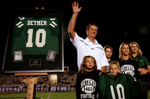 Ty Detmer and his family attend a ceremony commemoriating the retiring of his jersey number at Southwest High School Dragon Stadium, Friday, October 19, 2007. Detmer was one of the most prolific passers in Texas history while at Southwest before winning the Heisman at Brigham Young and going on to a long NFL career. Nicole Fruge/San Antonio Express News Photo: NICOLE FRUGE, Express-News / SAN ANTONIO EXPRESS-NEWS
