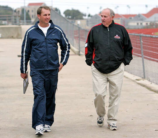 Ty Detmer walks with his dad, Sonny Detmer, to begin a coaching session with kids at a football camp at Lake Travis High School Saturday, February 10, 2007.   TY DETMER AT LAKE TRAVIS HIGH SCHOOL WITH HEISMAN TROPHY   FEBRUARY 10, 2007.    TOM REEL/STAFF Photo: TOM REEL, Express-News / SAN ANTONIO EXPRESS-NEWS