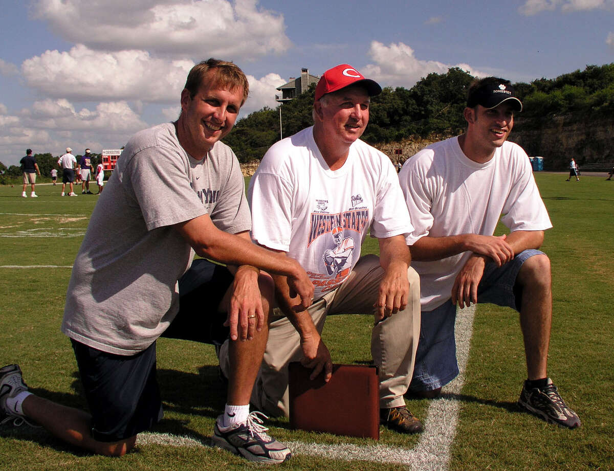 Sonny Detmer, middle, and his sons, Ty, left, and Koy Detmer, in 2004.
