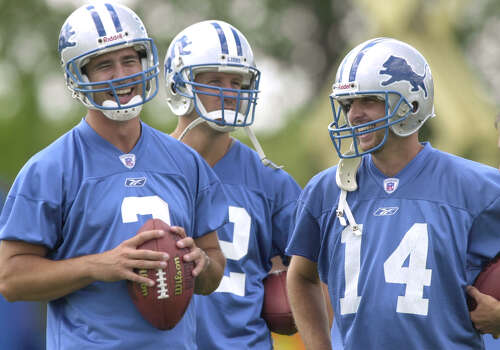Detroit Lions' Joey Harrington, left, shares a laugh with fellow quarterbacks Scott Dreisbach, center, and Ty Detmer during practice at training camp in Allen Park, Mich., Tuesday, July 23, 2002. Harrington was the team's top pick in this year's draft. (AP Photo/Paul Sancya) Photo: Express-News