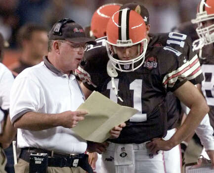 Cleveland Browns head coach Chris Palmer, left, goes over strategy with quarterback Ty Detmer (11) before the Browns first offensive series against the Pittsburgh Steelers, Sunday, Sept. 12, 1999, in Cleveland. Palmer is now the offensive coordinator for the expansion Texans. (AP Photo/Mark Duncan) Photo: Express-News