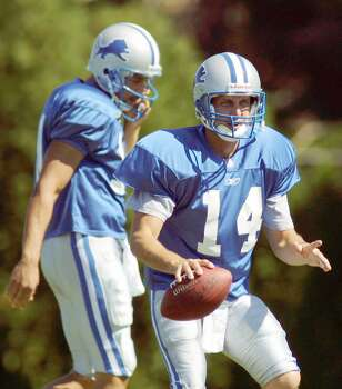 Detroit Lions quarterback Ty Detmer (14) takes a snap during practice in front of Charlie Batch, left, during practice Wednesday, Sept. 12, 2001, in Pontiac, Mich. Detmer will have a chance to make his mark when the Lions return to practice Monday, Sept. 17, 2001, and football resumes its routine after a weekend off to mourn and honor victims of Tuesday's terrorist attacks on New York and Washington. Certainly, it will be a golden chance at this stage of his career, and probably his last. (AP Photo/Duane Burleson, file) Photo: Express-News