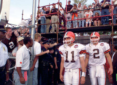 Ty Detmer (#11) of Southwest High School in San Antonio, followed by his understudy Tim Couch leads the new Cleveland Browns onto the field Monday Aug. 9, 1999 at the Hall of Fame game in Canton, Ohio. Photo: Express-News