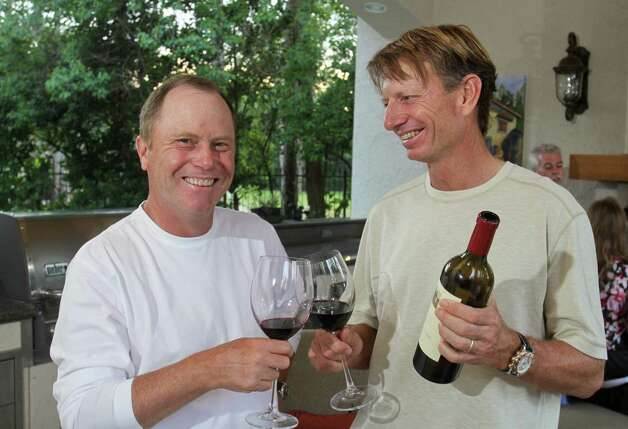 (For the Chronicle/Gary Fountain, May 5, 2012)  Golfers and serious wine collectors, Jeff Sluman, left, and Brad Faxon discussing and enjoying a glass of wine. Photo: Gary Fountain / Copyright 2012 Gary Fountain.