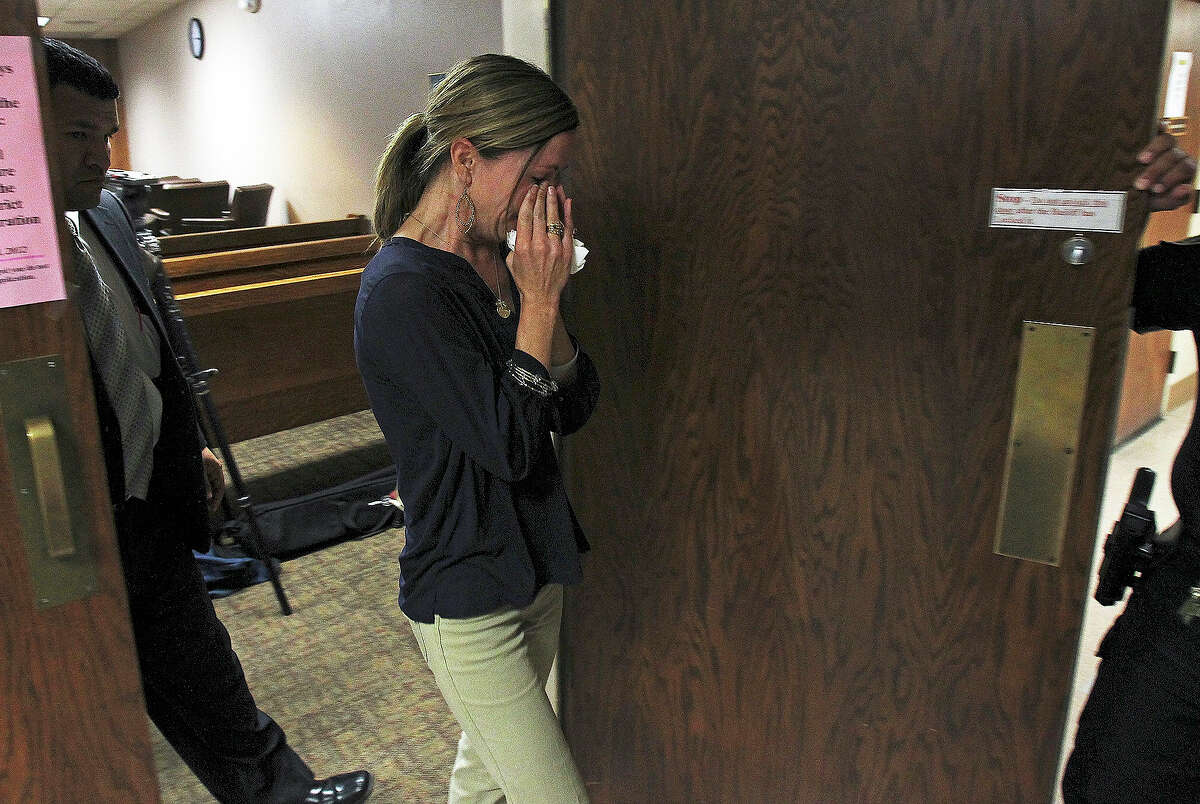 Traci Lopez, whose daughter Ava who was severely injured after being hit by a car driven by Julie Ann Bronson, left the Bexar County Courthouse sobbing Tuesday, May 15, 2012.