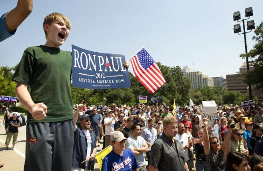Jordan Malone, 11, cheers for Ron Paul  at The Tea Party Express rally at the Capitol in Austin, Texas, on Sunday May 6, 2012. (Jay Janner / Associated Press)