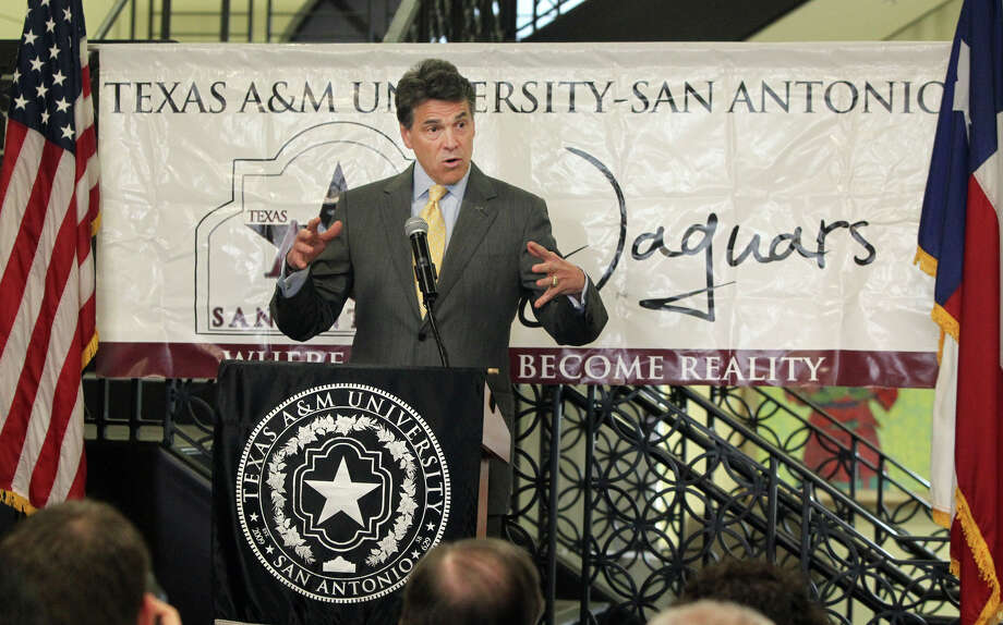 Gov. Rick Perry told Texas educators Tuesday, May 15, 2012, that he agrees with the University of Texas regents' decision to impose a two-year freeze on undergraduate tuition for state residents, saying education costs need to be kept down. Photo: JOHN DAVENPORT, SAN ANTONIO EXPRESS-NEWS