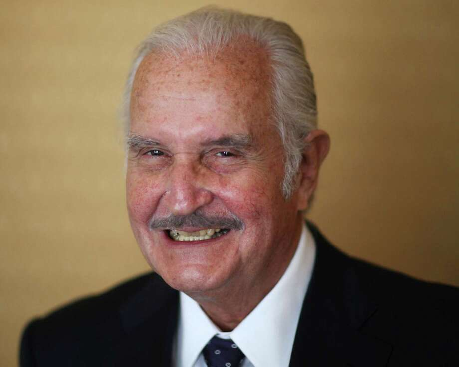 FILE - In this March 12, 2012 file photo, Mexican author Carlos Fuentes poses for a photo after a press conference in Mexico City. Fuentes, Mexico's most celebrated novelist and among Latin America's most prominent authors, died on May 15, 2012. (AP Photo/Alexandre Meneghini, File) Photo: Alexandre Meneghini / AP