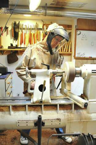 Joshua Friend of J. Friend Woodworks works at his lathe in his shop. He will be one of more than two dozen exhibitors at the Norwalk-Wilton Tree Festival, which will take place on Saturday, May 19, 2012, from 11 a.m. to 3 p.m. at Cranbury Park, Norwalk, Conn. He plans on bringing a smaller lathe, so he can do some demonstrations and craft some spinning tops, which he hopes to hand out. Photo: Contributed Photo