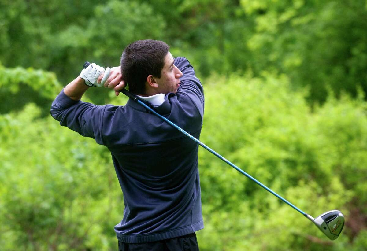 Greenwich's Stephen Pastore tees off as Greenwich High School hosts New Canaan in a boys golf match at the Griffith E. Harris Golf Course in Greenwich, Conn., May 15, 2012.