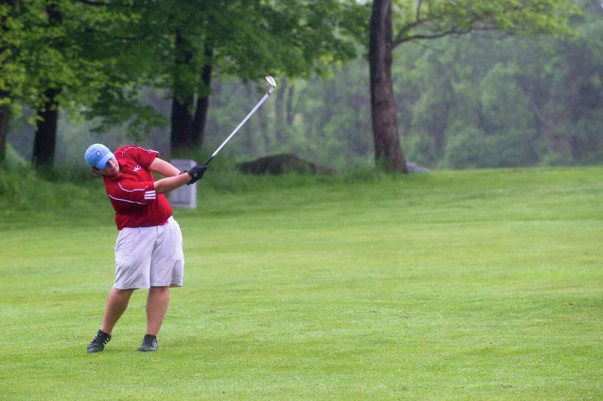 New Canaan's number two Parker Dennis in action as Greenwich High School hosts New Canaan in a boys golf match at the Griffith E. Harris Golf Course in Greenwich, Conn., May 15, 2012.