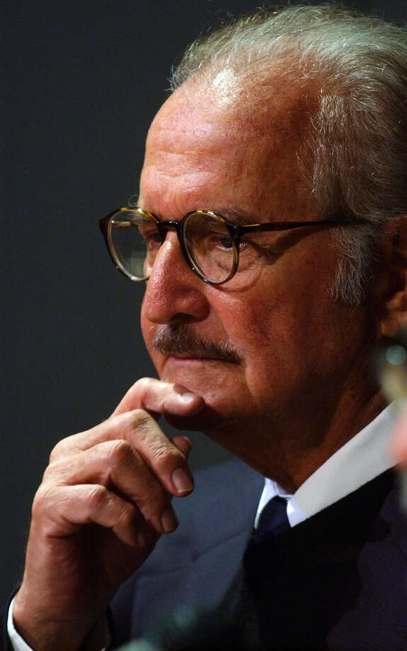 Mexican novelist Carlos Fuentes  listens to a question during a news conference at the Instituto de Mexico on Tuesday, Feb. 10, 2004. Photo: JERRY LARA, SAN ANTONIO EXPRESS-NEWS / SAN ANTONIO EXPRESS-NEWS