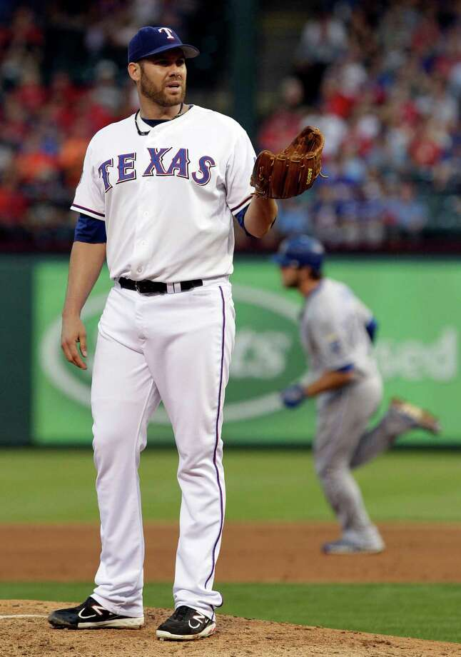 Two throwing errors by Rangers starter Colby Lewis led to five unearned runs for the Royals. Photo: AP