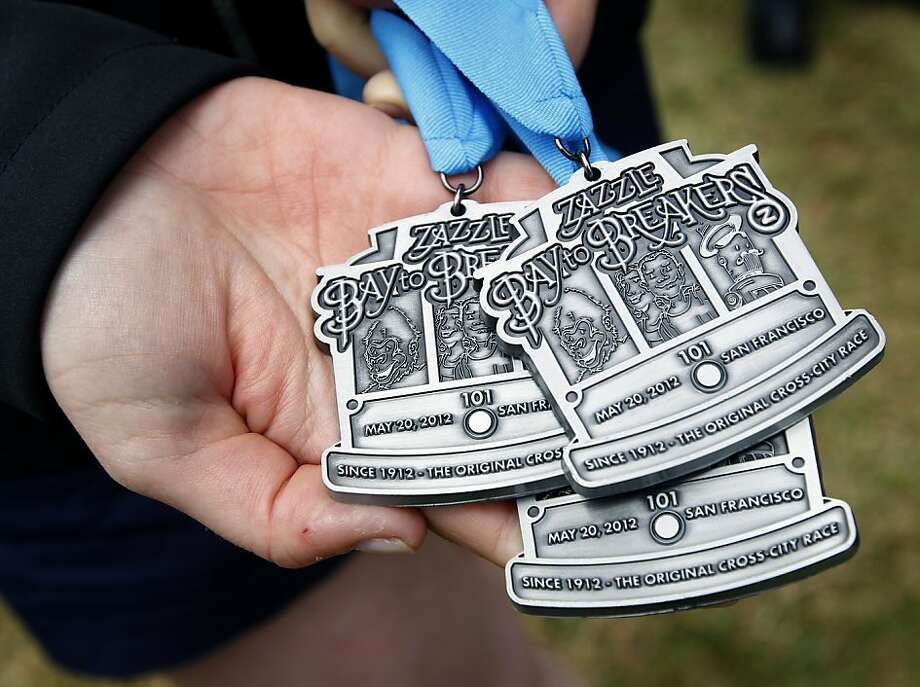 A Bay to Breakers official holds medals that will be presented to every participant that finishes this weekend's footrace. Police officials reminded runners to behave themselves, during a news conference in San Francisco, Calif. on Tuesday, May 15, 2012. Photo: Paul Chinn, The Chronicle
