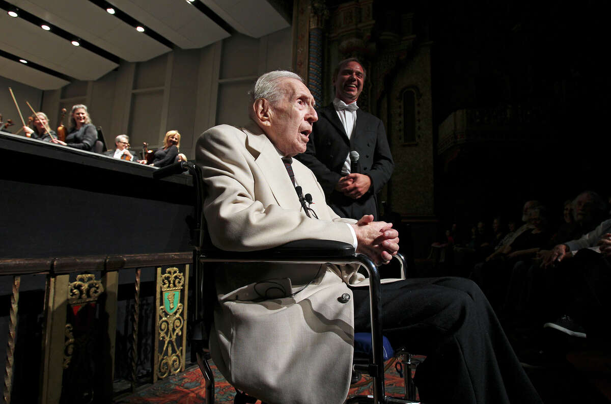Renowned writer Jacques Barzun addresses the audience at a San Antonio Symphony concert held in his honor Tuesday night, May 15, 2012. Music Director Sebastian Lang-Lessing stands to his left.