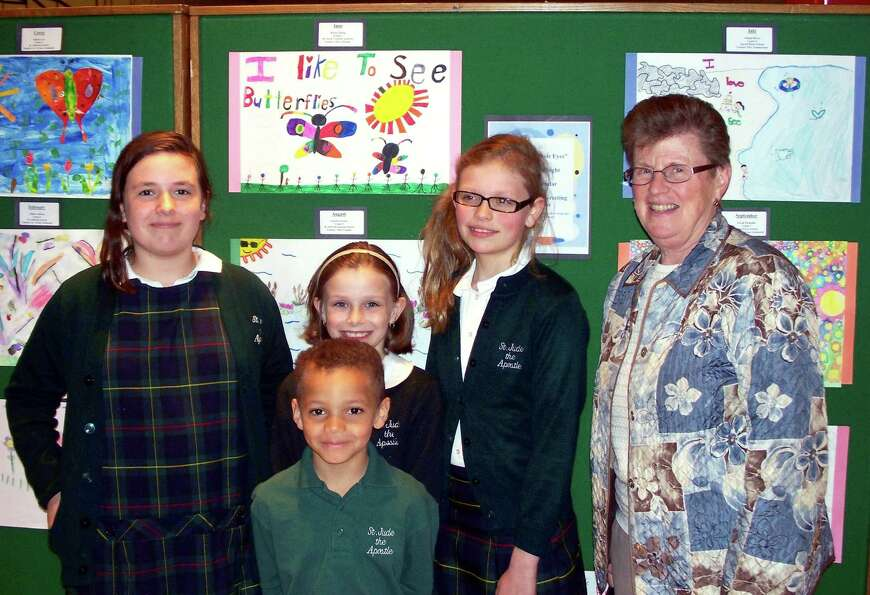 St. Jude the Apostle School students Jessica Seney, Lily Massey, Jayden Johnson, and Gabrielle Swide