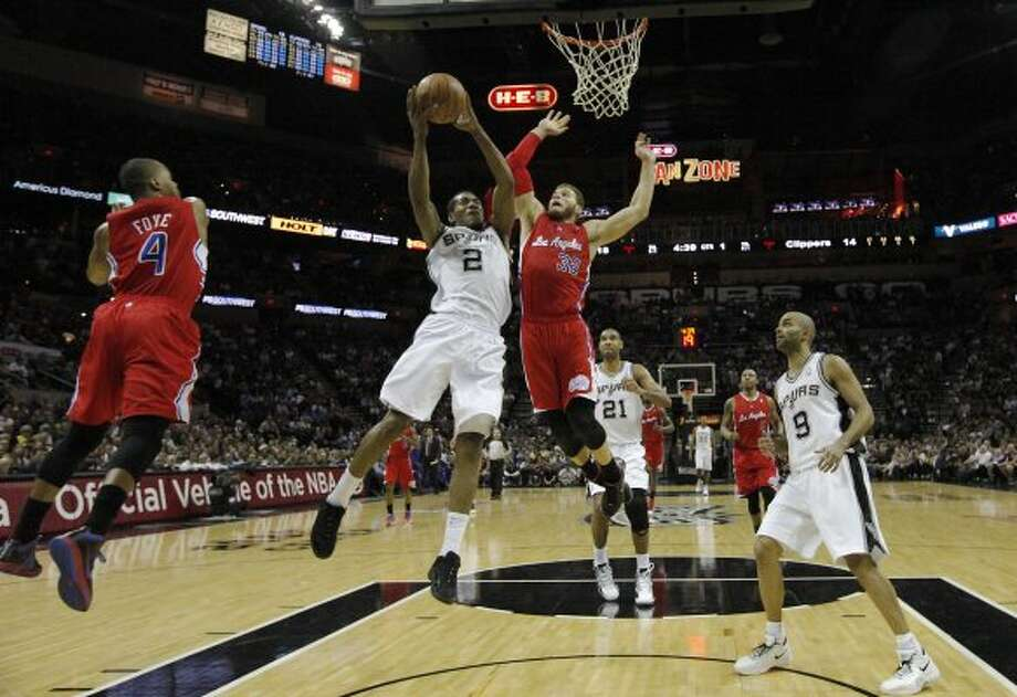 Spurs' Kawhi Leonard (02) goes up for a shot against Los Angeles Clippers' Blake Griffin (32) in the first half in Game 1 of the Western Conference semi-finals at the AT&T Center on Tuesday, May 15, 2012. Kin Man Hui/Express-News. (Kin Man Hui / SAN ANTONIO EXPRESS-NEWS)
