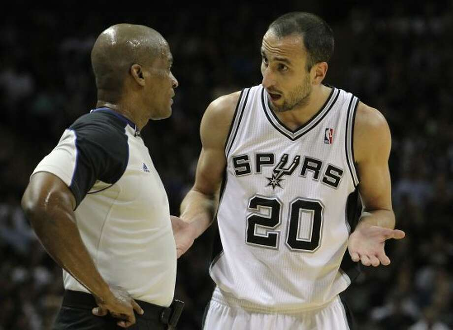 Spurs' Manu Ginobili (20) confers with official Derrick Collins during a break in the game against the Los Angeles Clippers in Game 1 of the Western Conference semi-finals at the AT&T Center on Tuesday, May 15, 2012. Kin Man Hui/Express-News. (Kin Man Hui / SAN ANTONIO EXPRESS-NEWS)