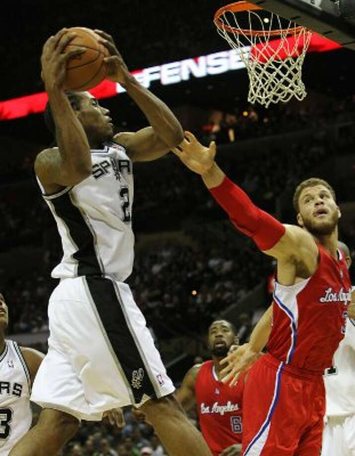 Spurs' Kawhi Leonard (02) grabs a rebound against Los Angeles Clippers' Blake Griffin (32) in the first half in Game 1 of the Western Conference semi-finals at the AT&T Center on Tuesday, May 15, 2012. Kin Man Hui/Express-News. (Kin Man Hui / SAN ANTONIO EXPRESS-NEWS)