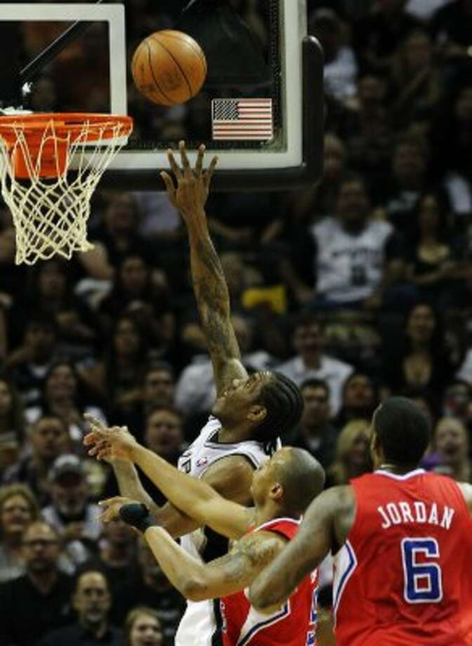 Spurs' Kawhi Leonard (02) puts up a shot over Los Angeles Clippers' Caron Butler (05) in the first half in Game 1 of the Western Conference semi-finals at the AT&T Center on Tuesday, May 15, 2012. Kin Man Hui/Express-News. (Kin Man Hui / SAN ANTONIO EXPRESS-NEWS)