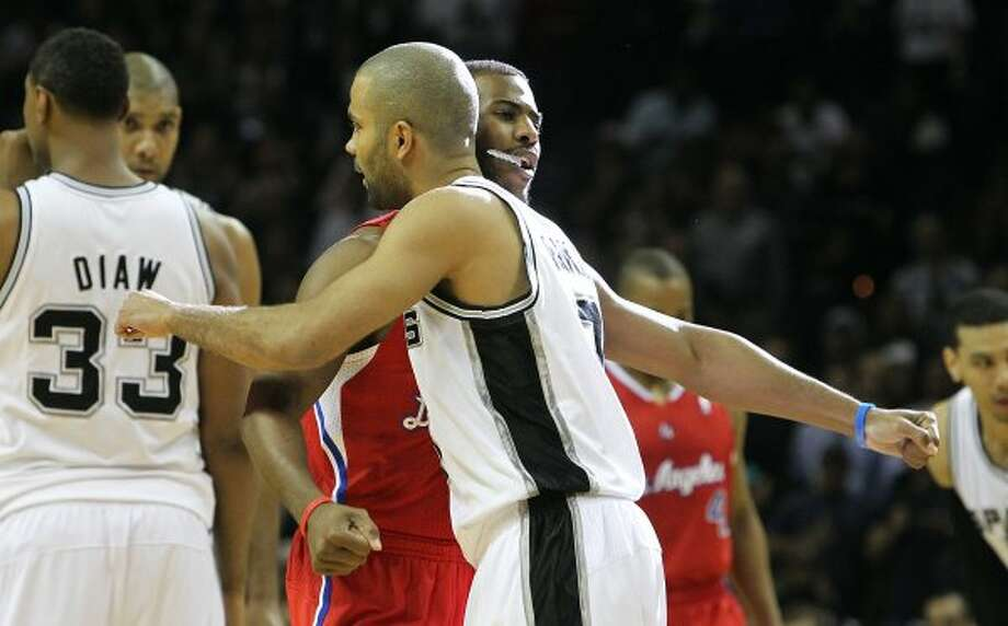 Spurs' Tony Parker (09) and Los Angeles Clippers' Chris Paul (03) offer one another hugs before Game 1 of the Western Conference semi-finals at the AT&T Center on Tuesday, May 15, 2012. Kin Man Hui/Express-News. (Kin Man Hui / SAN ANTONIO EXPRESS-NEWS)
