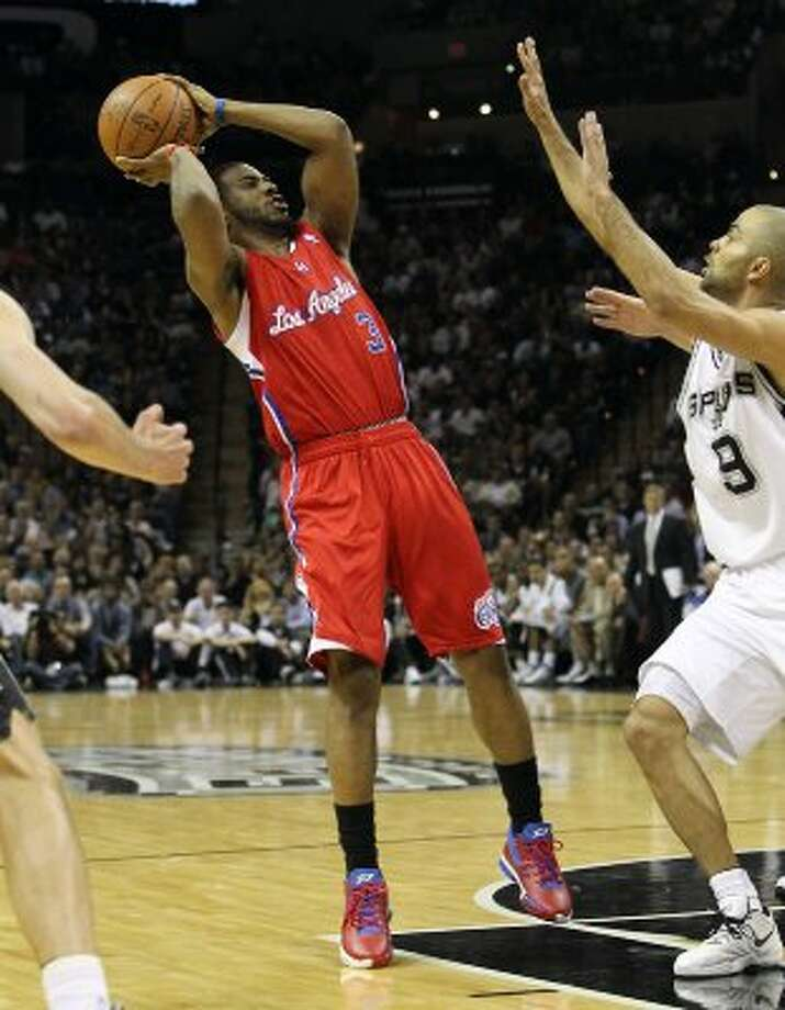Los Angeles Clippers' Chris Paul (03) takes a last second shot over Spurs' Tony Parker (09) in the first quarter in Game 1 of the Western Conference semi-finals at the AT&T Center on Tuesday, May 15, 2012. Kin Man Hui/Express-News. (Kin Man Hui / SAN ANTONIO EXPRESS-NEWS)