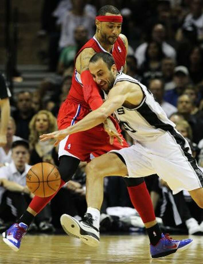 Spurs' Manu Ginobili (20) attempts to drive around Los Angeles Clippers' Kenyon Martin (02) in the first half in Game 1 of the Western Conference semi-finals at the AT&T Center on Tuesday, May 15, 2012. Kin Man Hui/Express-News. (Kin Man Hui / SAN ANTONIO EXPRESS-NEWS)