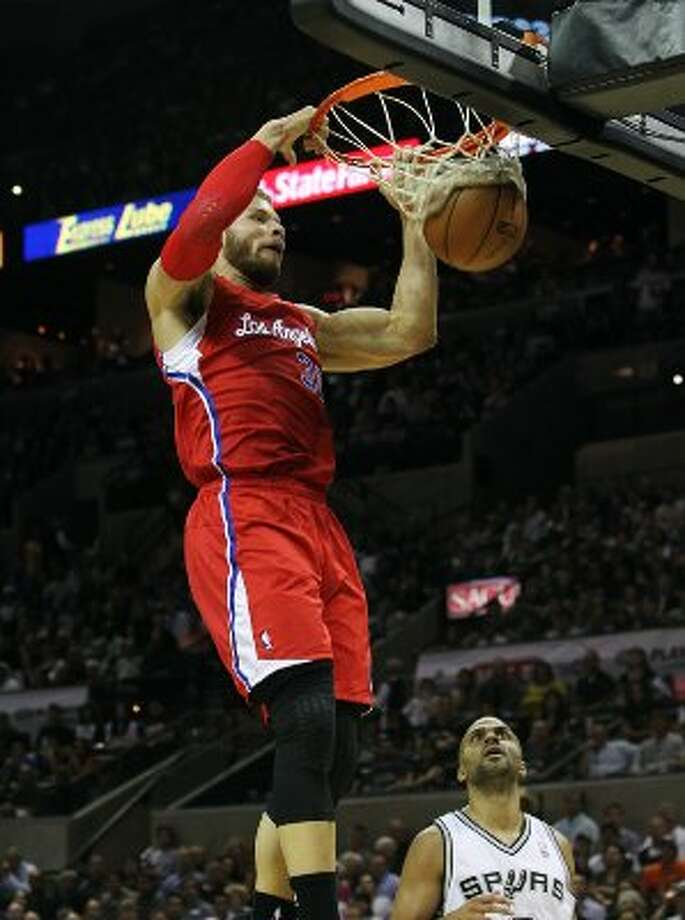 Los Angeles Clippers' Blake Griffin (32) dunks over Spurs' Tony Parker (09) in the first half in Game 1 of the Western Conference semi-finals at the AT&T Center on Tuesday, May 15, 2012. Kin Man Hui/Express-News. (Kin Man Hui / SAN ANTONIO EXPRESS-NEWS)