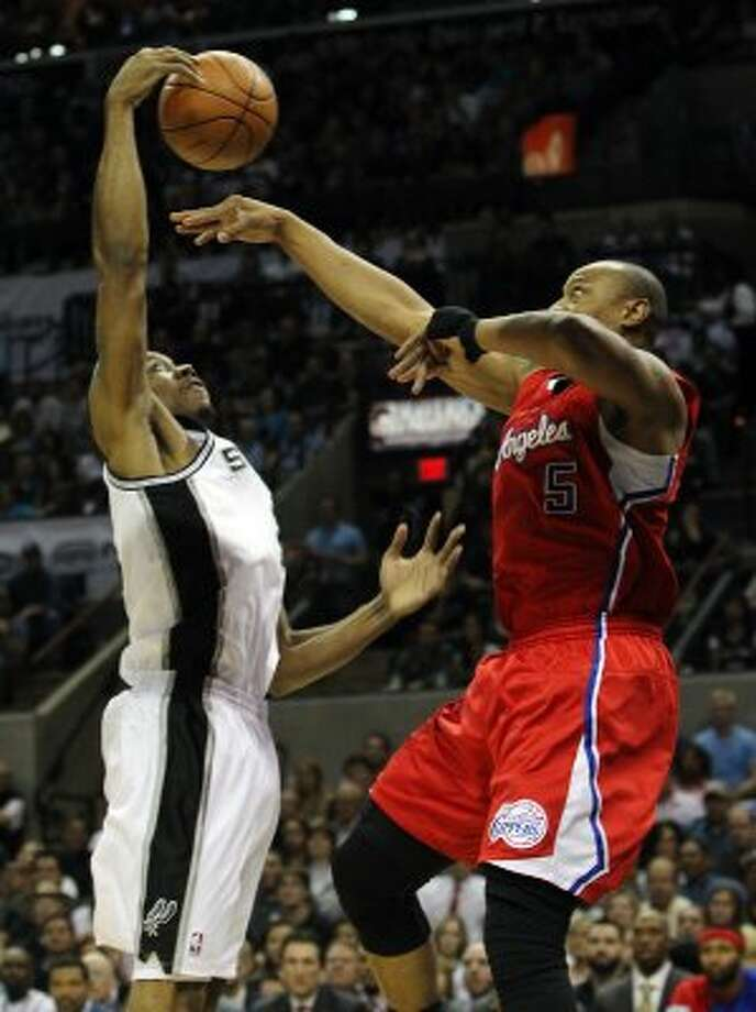 Spurs' Kawhi Leonard (02) steal a ball of out the air against Los Angeles Clippers' Caron Butler (05) in the first half in Game 1 of the Western Conference semi-finals at the AT&T Center on Tuesday, May 15, 2012. Kin Man Hui/Express-News. (Kin Man Hui / SAN ANTONIO EXPRESS-NEWS)