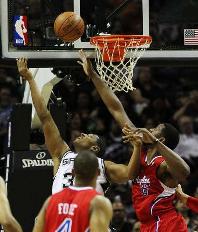 Spurs'  Boris Diaw (33) takes a reverse layup against Los Angeles Clippers' DeAndre Jordan (06) in the first half in Game 1 of the Western Conference semi-finals at the AT&T Center on Tuesday, May 15, 2012. Kin Man Hui/Express-News. (Kin Man Hui / SAN ANTONIO EXPRESS-NEWS)
