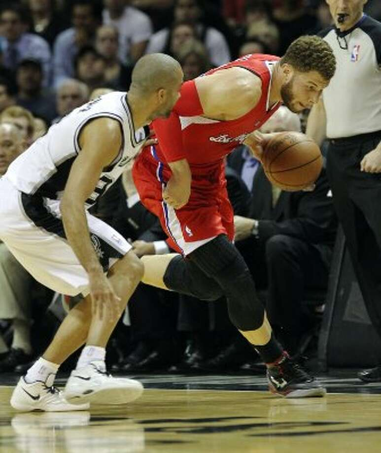 Spurs' Tony Parker (09) gets the ball stolen by Los Angeles Clippers' Blake Griffin (32) in the first half in Game 1 of the Western Conference semi-finals at the AT&T Center on Tuesday, May 15, 2012. Kin Man Hui/Express-News. (Kin Man Hui / SAN ANTONIO EXPRESS-NEWS)