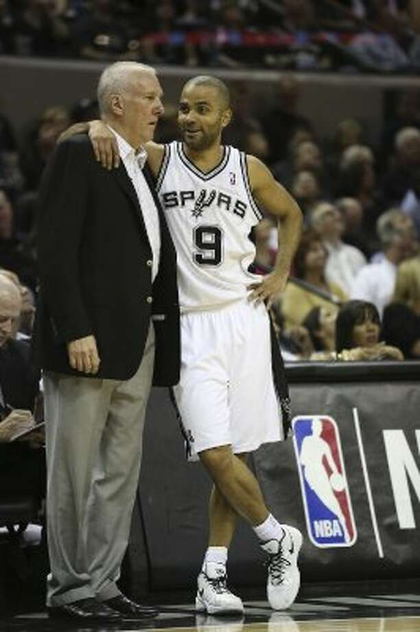 SPURS -- San Antonio Spurs Tony Parker talks with head coach Gregg Popobich during the first half of game one in the Western Conference semifinals against the Los Angeles Clippers at AT&T Center, Monday, May 15, 2012. Jerry Lara/San Antonio Express-News (Jerry Lara / San Antonio Express-News)