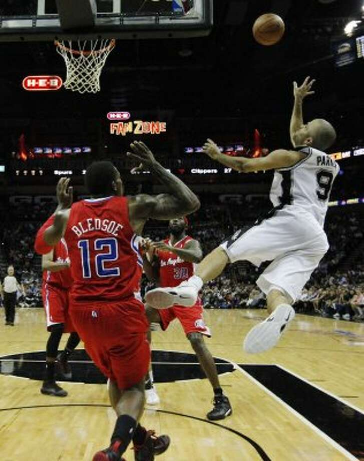 Spurs' Tony Parker (09) takes a wild shot as he's fouled by Los Angeles Clippers' Eric Bledsoe (12) in the first half in Game 1 of the Western Conference semi-finals at the AT&T Center on Tuesday, May 15, 2012. Kin Man Hui/Express-News. (Kin Man Hui / SAN ANTONIO EXPRESS-NEWS)