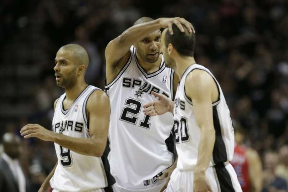 SPURS -- San Antonio Spurs Tony Parker, Tim Duncan and Manu Ginobili celebrate at mid court during their win against the Los Angeles Cllippers in game one of the Western Conference semifinals at AT&T Center, Tuesday, May 15, 2012. The Spurs won 108-92, to lead the series, 1-0. Jerry Lara/San Antonio Express-News (Jerry Lara / San Antonio Express-News)