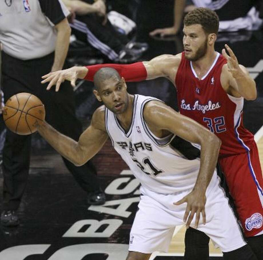 FOR SPORTS - Spurs' Tim Duncan looks to pass around Clippers' Blake Griffin during second half action of Game 1 of the Western Conference semifinals Monday May 15, 2012 at the AT&T Center. The Spurs won 108-92. (PHOTO BY EDWARD A. ORNELAS/SAN ANTONIO EXPRESS-NEWS) (EDWARD A. ORNELAS / SAN ANTONIO EXPRESS-NEWS)