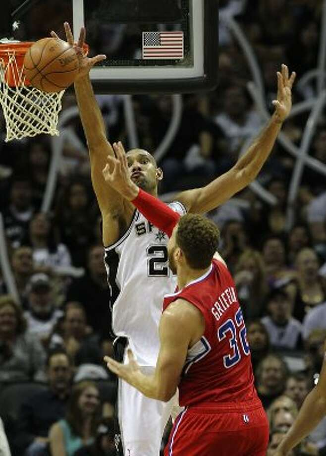 Spurs' Tim Duncan (21) reaches to block a shot by Los Angeles Clippers' Blake Griffin (32) in the second half of Game 1 of the Western Conference semi-finals at the AT&T Center on Tuesday, May 15, 2012. Spurs defeated the Clippers, 108-92. Kin Man Hui/Express-News. (Kin Man Hui / SAN ANTONIO EXPRESS-NEWS)