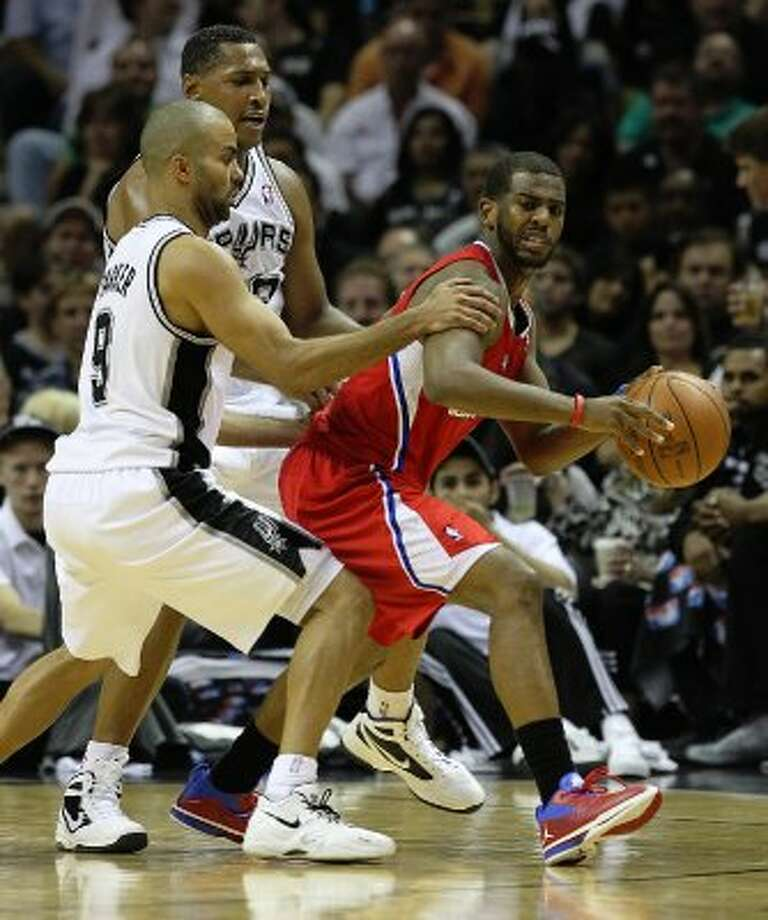 Spurs' Tony Parker (09) and Boris Diaw (33) apply pressure against Los Angeles Clippers' Chris Paul (03) in the second half of Game 1 of the Western Conference semi-finals at the AT&T Center on Tuesday, May 15, 2012. Spurs defeated the Clippers, 108-92. Kin Man Hui/Express-News. (Kin Man Hui / SAN ANTONIO EXPRESS-NEWS)
