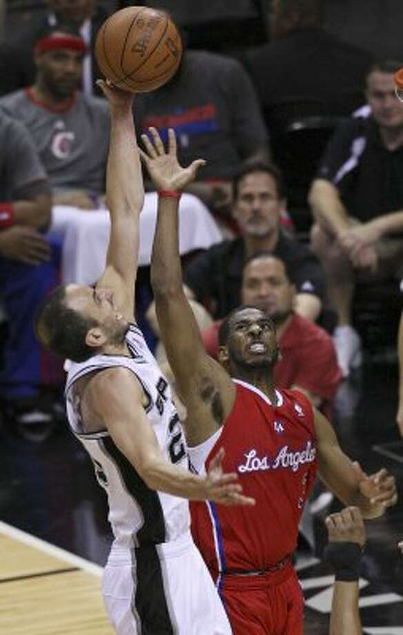 Spurs' Manu Ginobili shoots over Clippers' Chris Paul during second half action of Game 1 of the Western Conference semifinals Monday May 15, 2012 at the AT&T Center. The Spurs won 108-92. (PHOTO BY EDWARD A. ORNELAS/SAN ANTONIO EXPRESS-NEWS) (EDWARD A. ORNELAS / SAN ANTONIO EXPRESS-NEWS)