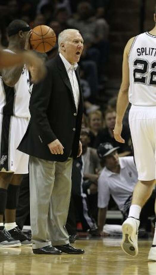 Spurs coach Gregg Popovich yells at Spurs center Tiago Splitter after a botched play against the Los Angeles Clippers in the second half of Game 1 of the Western Conference semi-finals at the AT&T Center on Tuesday, May 15, 2012. Spurs defeated the Clippers, 108-92. Kin Man Hui/Express-News. (Kin Man Hui / SAN ANTONIO EXPRESS-NEWS)