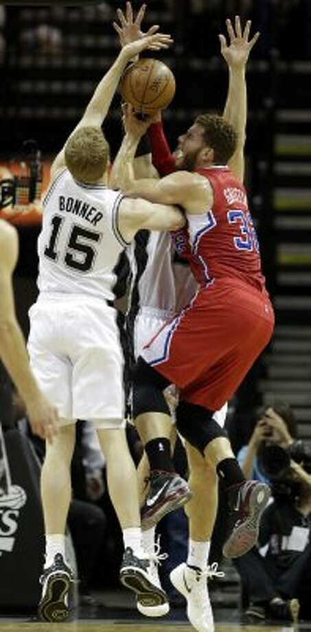 Spurs Matt Bonner and Tiago Splitter tie up Los Angeles Clippers Blake Griffin during the first half of game one in the Western Conference semifinals at AT&T Center, Tuesday, May 15, 2012. Jerry Lara/San Antonio Express-News (Jerry Lara / San Antonio Express-News)