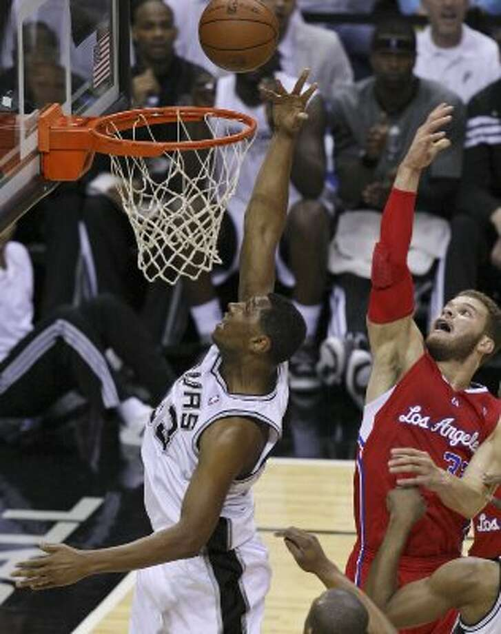 Spurs' Boris Diaw grabs for a rebound against Clippers' Blake Griffin during first half action of Game 1 of the Western Conference semifinals Monday May 15, 2012 at the AT&T Center. (PHOTO BY EDWARD A. ORNELAS/SAN ANTONIO EXPRESS-NEWS) (EDWARD A. ORNELAS / SAN ANTONIO EXPRESS-NEWS)