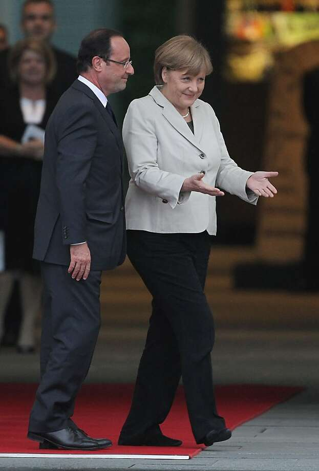 BERLIN, GERMANY - MAY 15:  German Chancellor Angela Merkel welcomes French President Francois Hollande at the Chancellery hours after Hollande's inauguration in Paris on May 15, 2012 in Berlin, Germany. Hollande has come to Berlin to discuss the current European debt crisis with Merkel and most importantly to find common ground, as he hopes to resolve the crisis with measures that mark a departure from the austerity packages favoured by Merkel.  (Photo by Sean Gallup/Getty Images) Photo: Sean Gallup, Getty Images