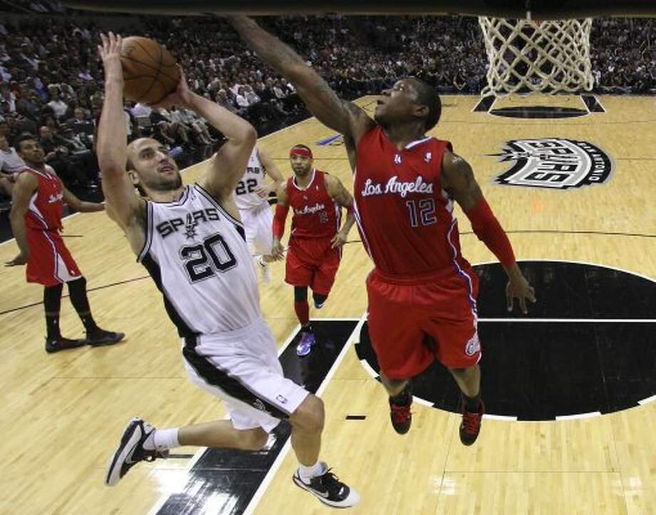 SPURS -- San Antonio Spurs Manu Ginobili drives the ball against Los Angeles Clippers Eric Bledsoe during the second half of game one in the Western Conference semifinals at AT&T Center, Tuesday, May 15, 2012. The Spurs won 108-92, to lead the series, 1-0. Jerry Lara/San Antonio Express-News (Jerry Lara / San Antonio Express-News)