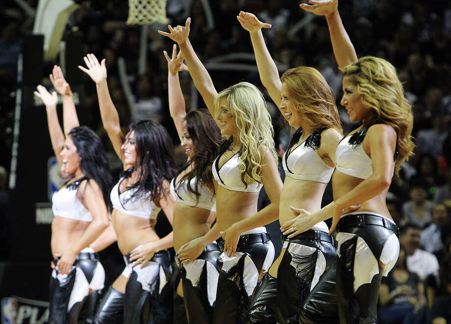 Spurs SilverDancer perform during a timeout in the Spurs game against the Los Angeles Clippers in the second half of Game 1 of the Western Conference semi-finals at the AT&T Center on Tuesday, May 15, 2012. Spurs defeated the Clippers, 108-92. Kin Man Hui/Express-News. Photo: Kin Man Hui, Express-News / San Antonio Express-News