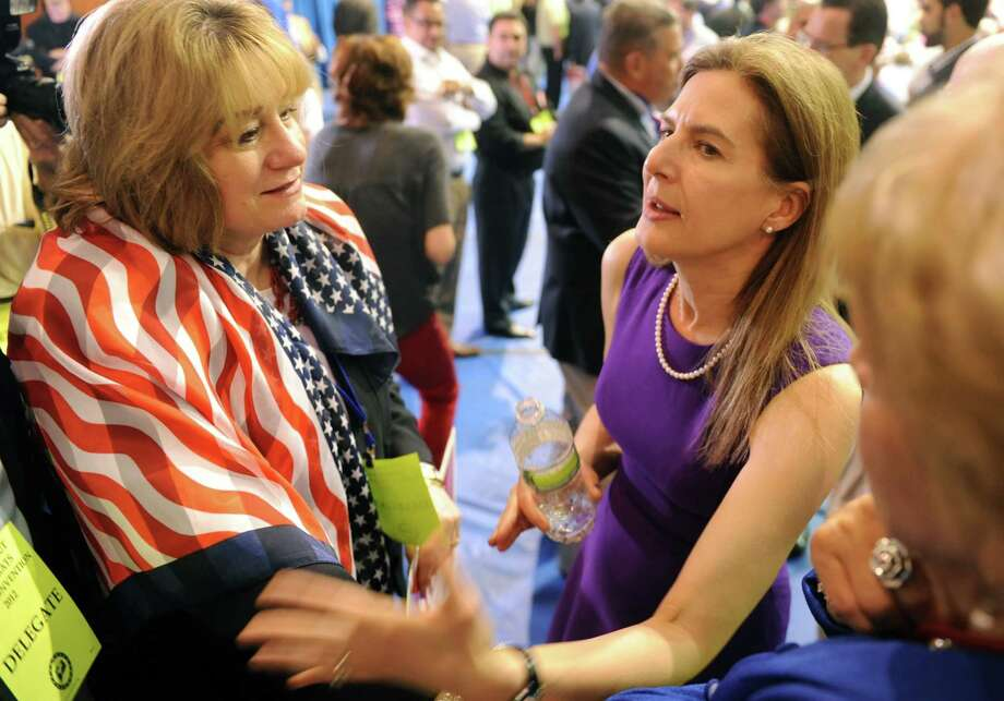 Former Secretary of the State Susan Bysiewicz, a candidate for U.S. Senate, talks to Christine Edwards, of Greenwich, during the Democratic State Convention at Central Connecticut State University's Kaiser Hall in New Britain Saturday, May 12, 2012. Photo: Autumn Driscoll / Connecticut Post
